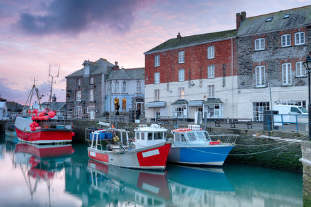 overfishing: Winter sunrise overfishing boats at Padstow harbour on the north coast of Cornwall Stock Photo