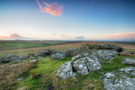 moorland: Wild, rugged and rocky moorland with ponies grazing in the distance near St Breward on Bodmin Moor in Cornwall Stock Photo