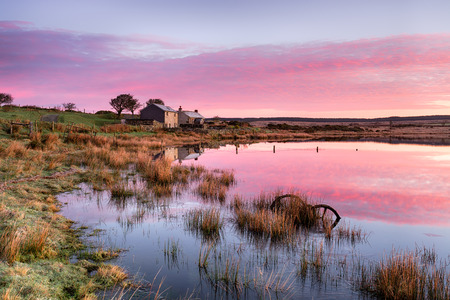 haunt: Stunning sunrise over Dozmary Pool on Bodmin Moor in Cornwall, a small natural lake steeped in Arthurian legend and reputedly the haunt of the Lady of the Lake