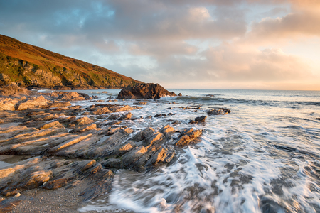 south coast: Sunset over the rocky beach at Hemmick on the south coast of Cornwall Stock Photo