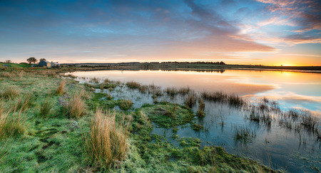 bodmin: Stunning sunrise over Dozmary Pool, a mysterious lake steeped in Arthurian Legend and situated on a remote part of Bodmin Moor in Cornwall