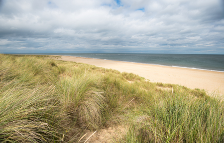 sand dunes: Looking out at the North Sea over the beach and sand dunes at Winterton on Sea on the Norfolk coast Stock Photo