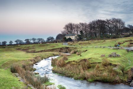 devon: A bleak lonely cottage on Dartmoor National Park in Devon