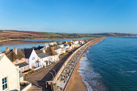Pretty cottages at Torcross on the Devon coast, the village sits on a strip of land overlooking Slapton Sands beach with a fresh water lake behind. Stock Photo