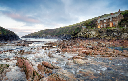 quin: Sunrise at Port Quin on the north coast of Cornwall Stock Photo