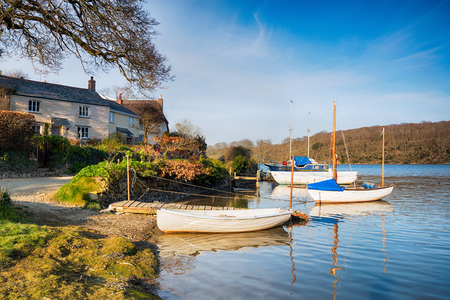inlet bay: Boats on the shore at St Clement near Truro in Cornwall Stock Photo