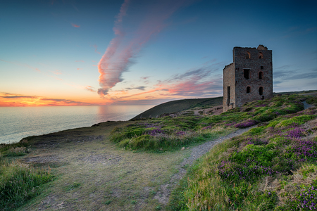 south west england: Dramatic sunset over the ruins of the Towanroath engine house on the South West Coast path at St Agnes in Cornwall Stock Photo
