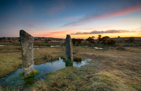 bodmin: Dusk at The Pipers, two standing stones on the edge of the Hurlers stone circle at Minions on Bodmin Moor in Cornwall