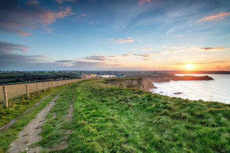 south west coast path: Stunning sunset on the South West Coast Path as it approaches Porth on the outskirts of Newquay in Cornwall