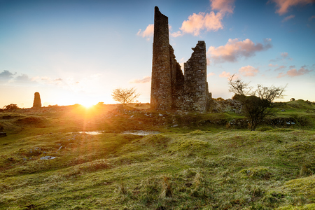 tine: Sunset over the ruins of old tine mine engine houses on Bodmin Moor in Cornwall