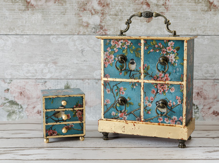 Beautiful handmade decoupaged jewellery boxes on a rustic background