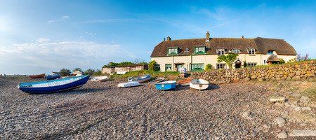 exmoor: Cottages and fishing boats at low tide at Porlock Weir on the Somerset Coast and part of Exmoor National Park