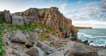 pembrokeshire: St Govans Chapel, a tiny hermit cell built in to limestone cliffs on the rugged south Pembrokeshire coast in Wales