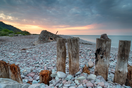 exmoor: Beautiful sunset over the beach at Porlock Weir, a part of Exmoor National Park in Somerset Stock Photo