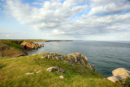 pembrokeshire: Rugged cliffs and coastline at St Govans Head on the Pembrokeshire Coast National Park in Wales, looking out towards Stackpole