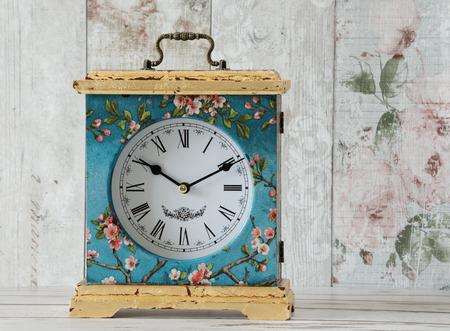 mantel: Handmade decoupaged mantel clock with gold leaf Stock Photo
