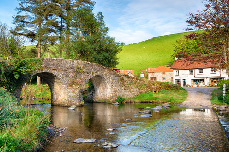 The bridge and ford at  Malmsmead in the Doone Valley directly on the border between Somerset and Devon and on Exmoor National Park Stock Photo