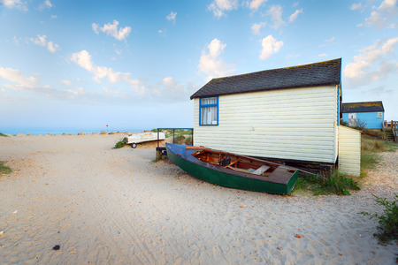 hengistbury: Boats and beach huts at Mudeford Spit near Christchurch in Dorset Stock Photo