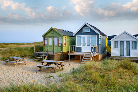 hengistbury: Beach huts on Mudeford Spit a narrow strip of sand between Hengistbury head and Mudeford at Christchurch in Dorset Stock Photo