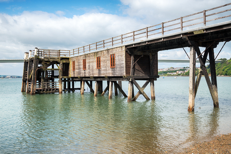A wooden jetty on the banks of the Cleddau River at Burton Ferry in Pembrokeshire