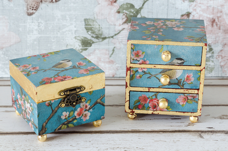 trinket: Hnadmade trinket box and mini chest of drawers on a shabby chic background
