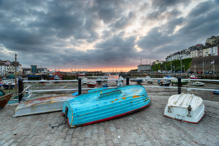 Dramatic sunrise sky over the harbour at Brixham in the Torbay district in Devon