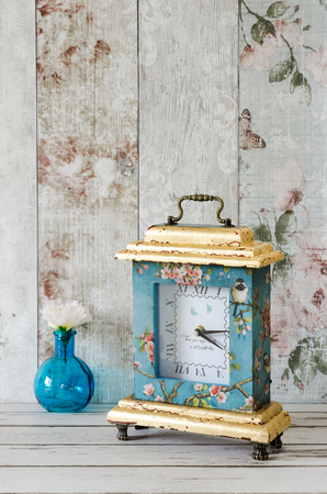 decoupage: Hand made clock with gold leaf gilding and decoupage Stock Photo