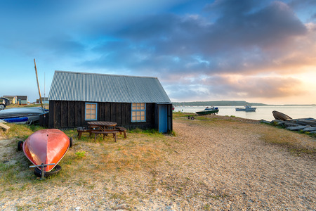 hengistbury: Boat sheds and beach huts at Mudeford Spit in Christchurch harbour on the Dorset coast