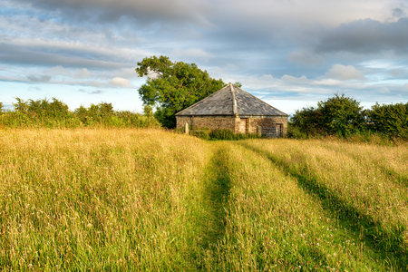 bodmin: An old barn in grassy meadows at Castle Canyke in Bodmin, Cornwall