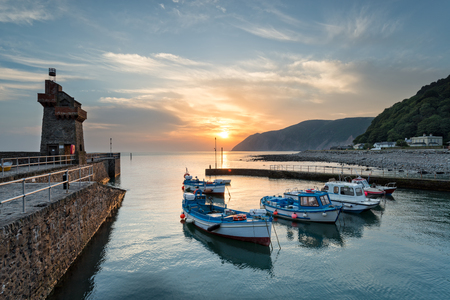 lynton: Vibrant sunsrise at Lynmouth on the north coast of Devon Stock Photo