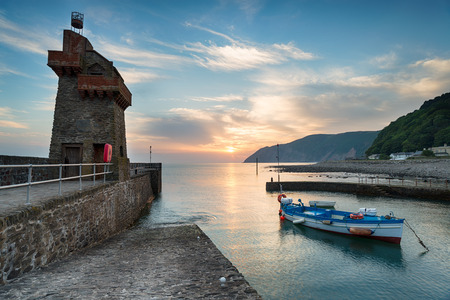 lynton: Sunrise over the Rhenish Tower on Lynmouth harbour on the north coast of Devon