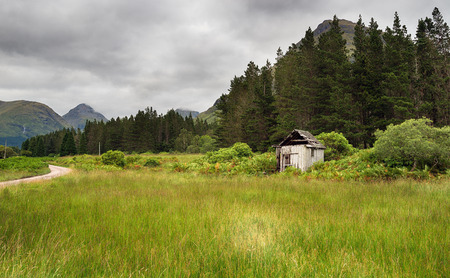 An old wooden shack on the edge of Glen Etive Forest near Glencoe in the highlands of Scotland