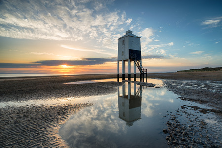 burnham: Stunning sunset sky over the wooden lighthouse on stilts at Burnham on Sea on the Somerset coast