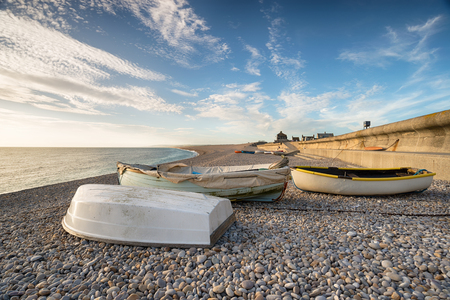 Boats on the beach at Chesil Cove on the Isle of Portland near Weymouth on the Dorset coast Reklamní fotografie