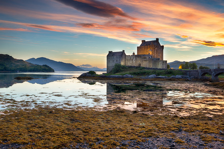 highland: Beautiful sunset over the castle at Eilean Donan in the Scottish Highlands
