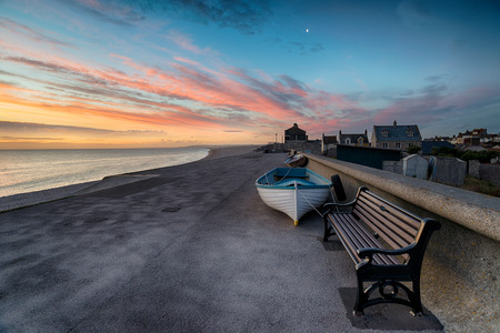jurassic coast: Stunning sunset at Chesil Cove in Portland, on the easter edge of Chesil Beach on Dorsets Jurassic coast Stock Photo