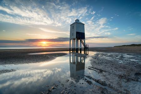 Sunset over the lighthouse at Burnham on Sea on the Somerset Coast Stock Photo