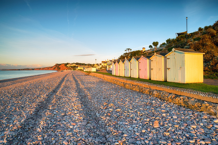 jurassic coast: Early morning sunshine on the beach at Budleigh Salterton on Devons Jurassic Coast Stock Photo