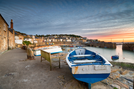 mousehole: Sunrise at Mousehole, a pretty fishing village near Penzance in Cornwall Stock Photo