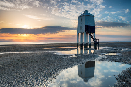 Beuatiful sunset over the beach and lighthouse at Burnham on Sea in Somerset
