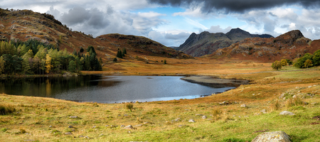 langdale pikes: Autumn at Blea Tarn with the Langdale Pikes imountains n the background Stock Photo