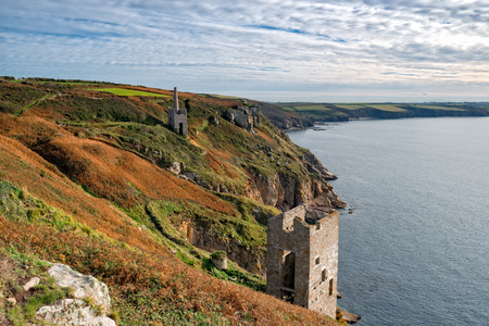 dramatically: Engine houses perched dramatically on the edge of cliffs at Rinsey near Porthleven in Cornwall
