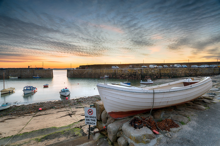 mousehole: Dawn at the harbour at Mousehole near Penzance on the Cornish coastline