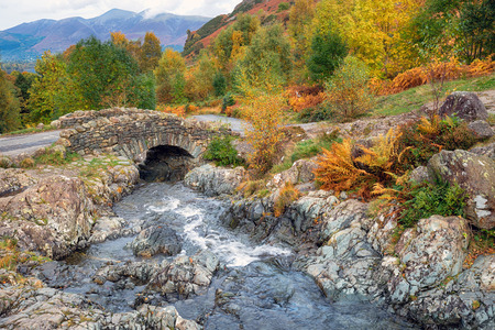 Ashness Bridge above the shores of Derwentwater near Keswick in the Lake District National Park in Cumbria Stock Photo