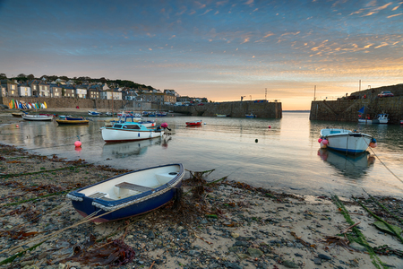 mousehole: Boats in the harbour at Mousehole near Penzance in Cornwall