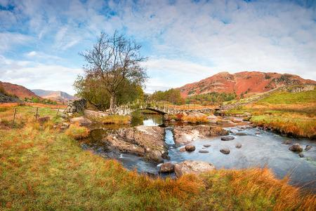 Slaters Bridge an ancient packhorse bridge at Little Langdale in Cumbria Stock Photo