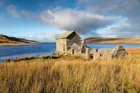 The ruins of an old boat house on the shores of Devoke Water in the Lake District National Park in Cubria