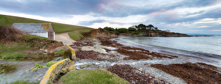 A panoramic view of Colona Beach below Chapel Point on the South West Coast path near Portmellon in Cornwall