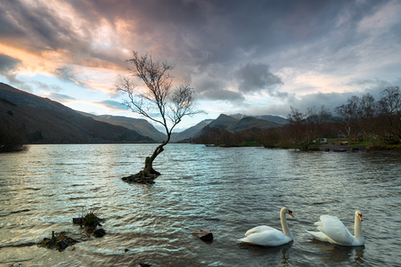 Stormy sunrise over Llyn Padarn lake in Snowdonia National Park in Wales