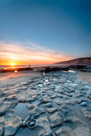 Beuatiful sunset over the beach at Dunraven Bay on the south coast of Wales
